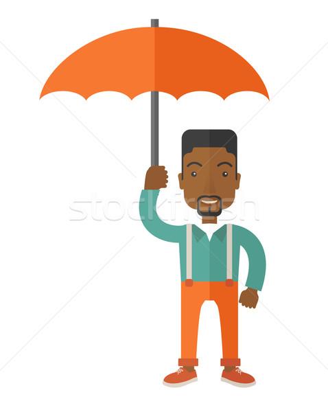 African-american businessman with umbrella as protection. Stock photo © RAStudio