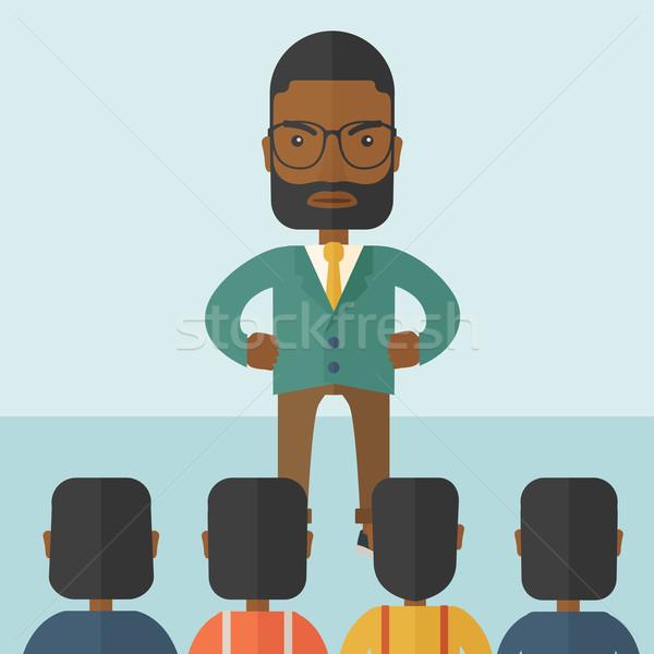 Angry black boss facing at his employees. Stock photo © RAStudio