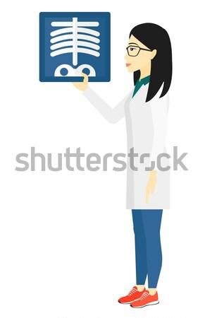 Doctor holding radiograph. Stock photo © RAStudio