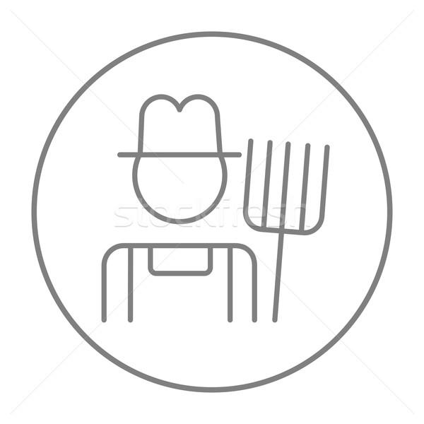 Farmer with pitchfork line icon. Stock photo © RAStudio