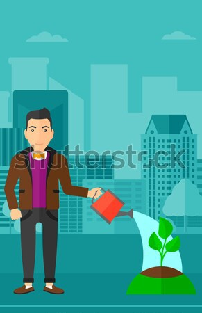 Woman watering tree with recycle sign instead of crown. Stock photo © RAStudio
