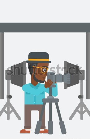 Photographer working with camera on a tripod. Stock photo © RAStudio