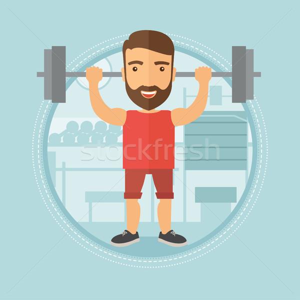 Man barbell gymnasium kaukasisch Stockfoto © RAStudio