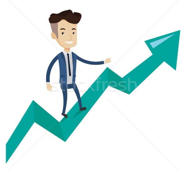Happy businessman standing on profit chart. Stock photo © RAStudio