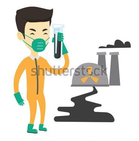 Homme rayonnement costume tube à essai scientifique permanent Photo stock © RAStudio
