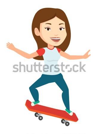 Kobieta jazda konna deskorolka szczęśliwy sportsmenka Zdjęcia stock © RAStudio