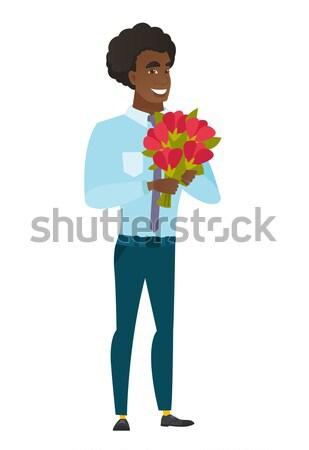 African groom holding a bouquet of flowers. Stock photo © RAStudio