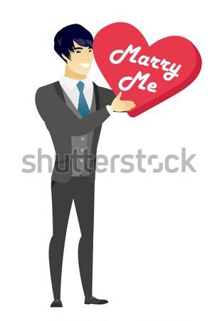Férfi készít házasság javaslat fiatal boldog Stock fotó © RAStudio