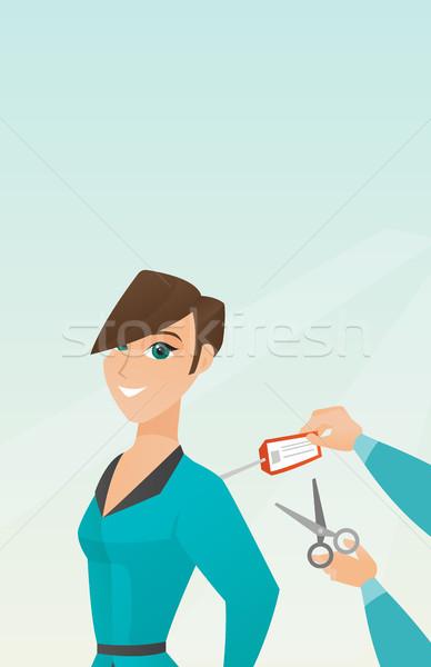 Caucasian woman cutting price tag off new jacket. Stock photo © RAStudio