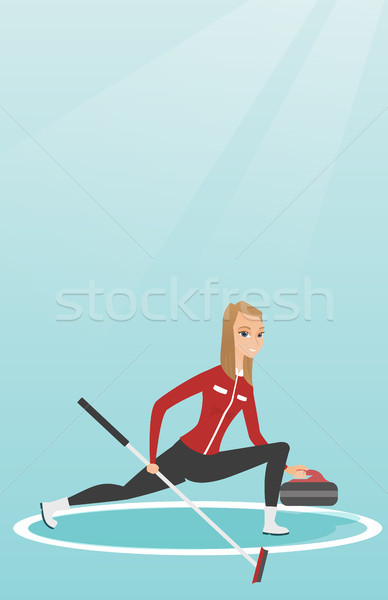 Stock photo: Sportswoman playing curling on a skating rink.