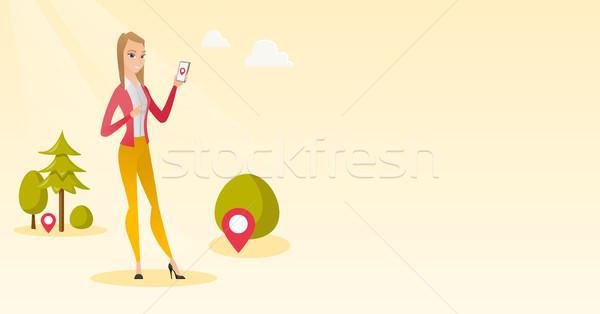 Stock fotó: Kaukázusi · nő · játszik · tevékenység · játék · okostelefon