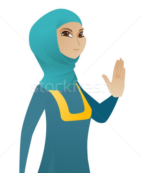 Young muslim business woman showing palm hand. Stock photo © RAStudio