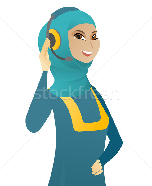Young muslim customer service operator in headset. Stock photo © RAStudio
