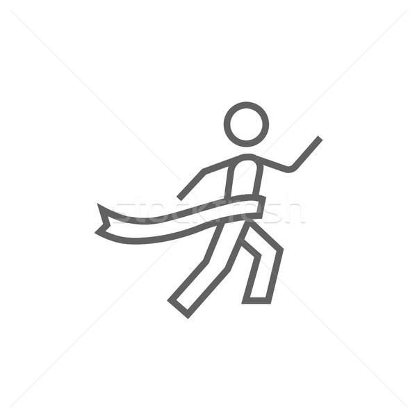 Winner crossing finish line icon. Stock photo © RAStudio