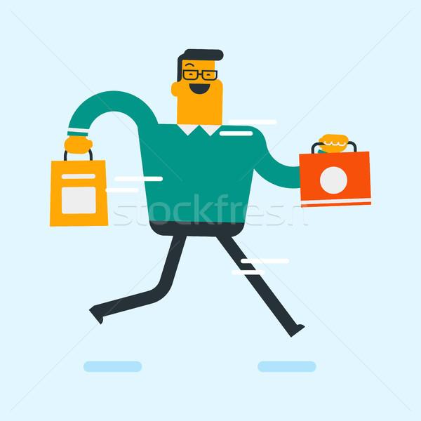 Caucasian white consumer holding shopping bags. Stock photo © RAStudio