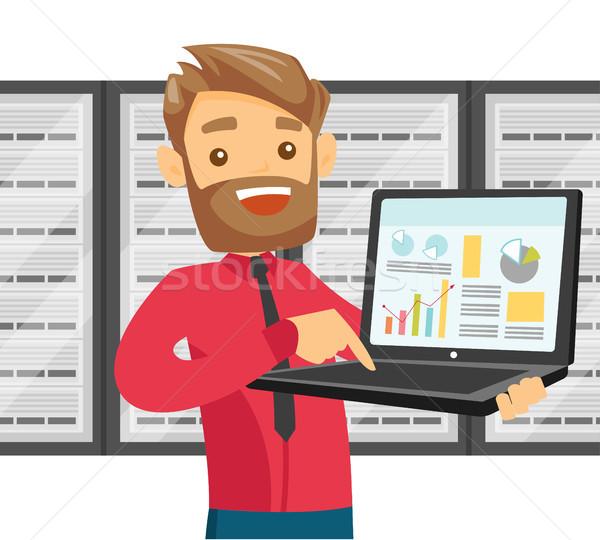 Biały człowiek data center laptop biały inżynier serwera Zdjęcia stock © RAStudio