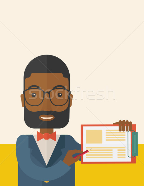Handsome black guy holding clipboard. Stock photo © RAStudio