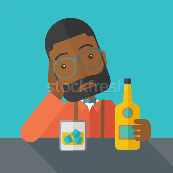 Sad african man alone in the bar drinking beer. Stock photo © RAStudio