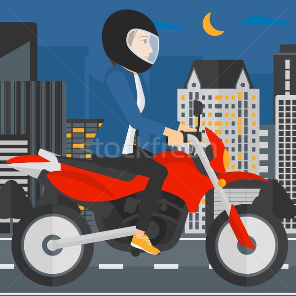 Woman riding motorcycle. Stock photo © RAStudio