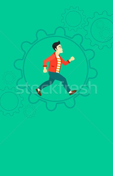 Homem corrida dentro engrenagem asiático grande Foto stock © RAStudio
