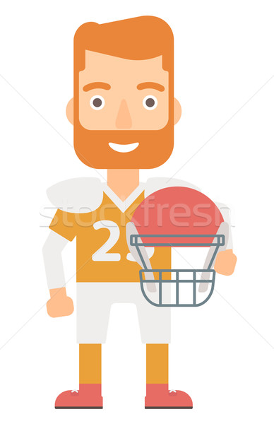 Rugby player with ball and helmet in hands. Stock photo © RAStudio