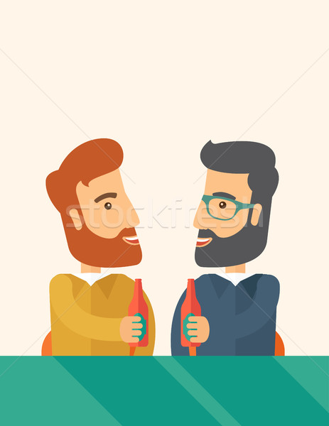 Two co- workers having fun drinking beer in a pub. Stock photo © RAStudio