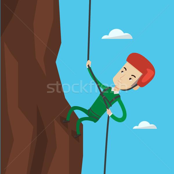 Stock fotó: Férfi · mászik · hegyek · kötél · kő · sisak
