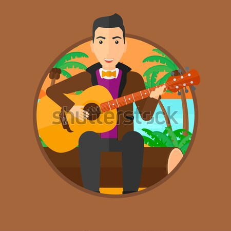 Musician playing acoustic guitar. Stock photo © RAStudio
