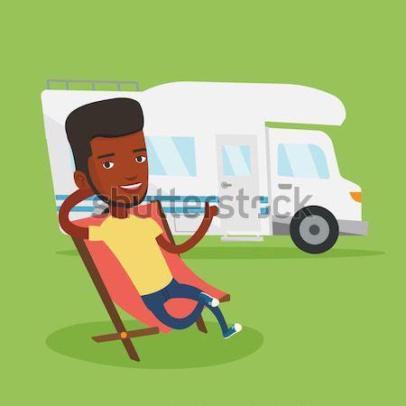 Man sitting in chair in front of camper van. Stock photo © RAStudio