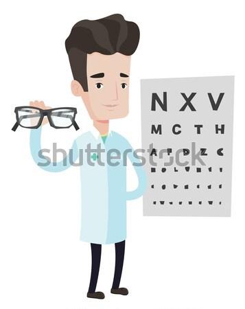 Profi szemorvos tart szemüveg ázsiai szemüveg Stock fotó © RAStudio