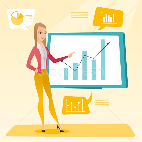 Businesswoman presenting review of financial data. Stock photo © RAStudio