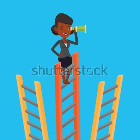 Businesswoman looking for business opportunities. Stock photo © RAStudio