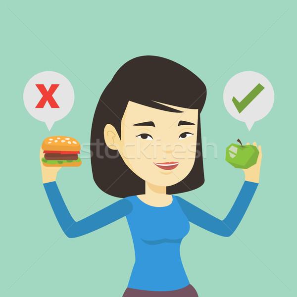 Mulher escolher hambúrguer asiático Foto stock © RAStudio