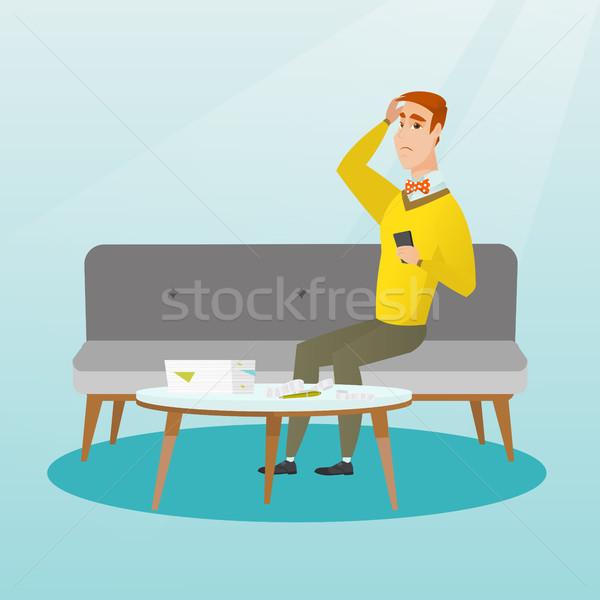 Unhappy caucasian man accounting home bills. Stock photo © RAStudio