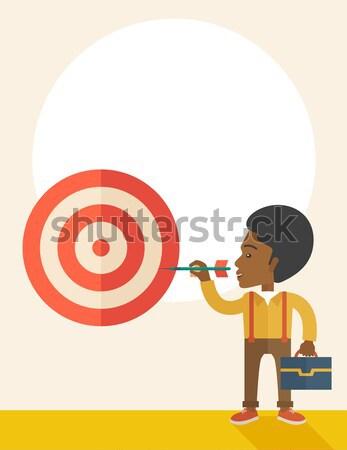 Young hindu businessman and dart board. Stock photo © RAStudio