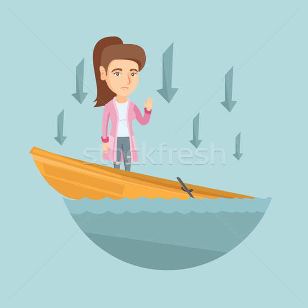 Caucasian business woman standing in sinking boat. Stock photo © RAStudio