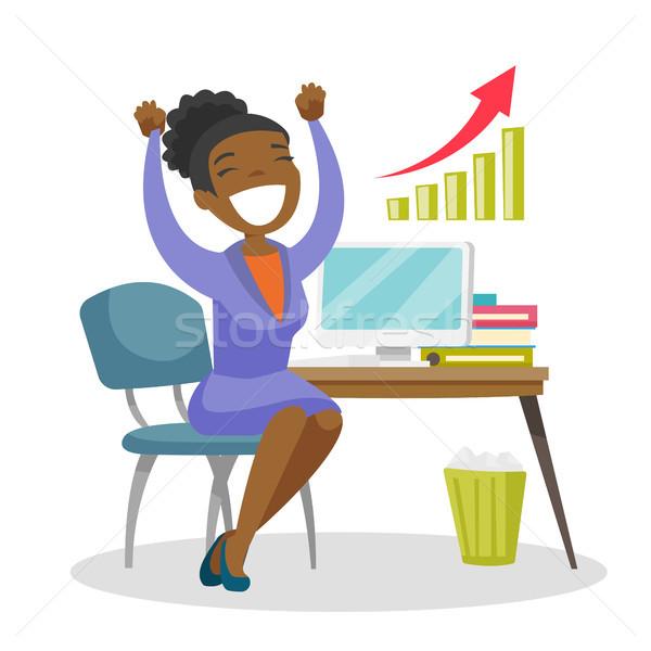 Successful entrepreneur celebrating at workplace. Stock photo © RAStudio