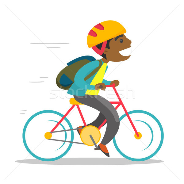 Young african-american boy riding a bicycle. Stock photo © RAStudio