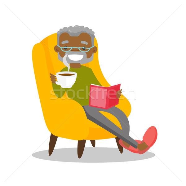 Senior african-american man reading a book. Stock photo © RAStudio