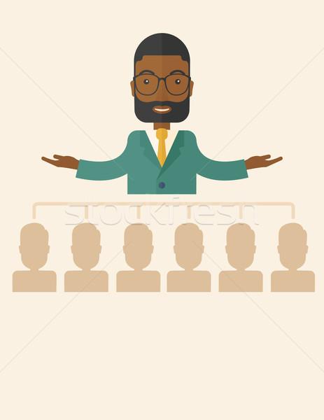 African-american man giving a buisness speech. Stock photo © RAStudio