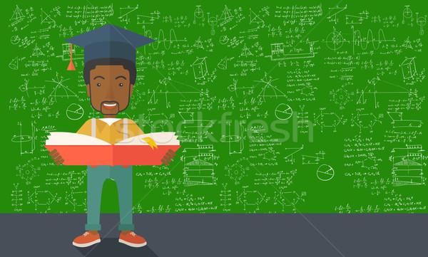 Man permanente afstuderen cap lezing boek Stockfoto © RAStudio