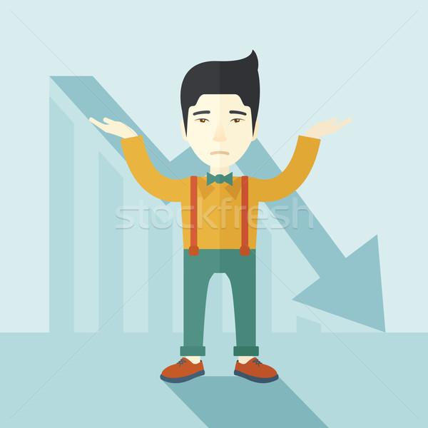Guy raising his arms with arrow down graph. Stock photo © RAStudio