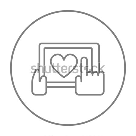 Hands holding tablet with heart sign line icon. Stock photo © RAStudio