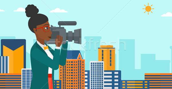 Camerawoman with video camera. Stock photo © RAStudio