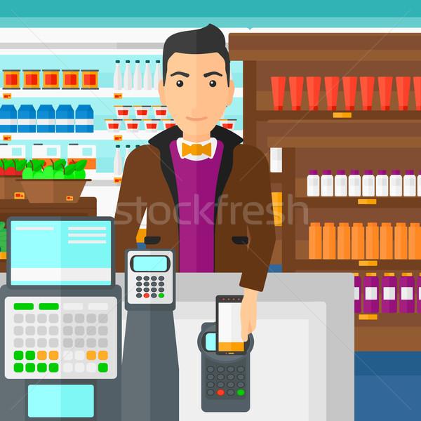 Vásárló fizet okostelefon férfi áruház polcok Stock fotó © RAStudio
