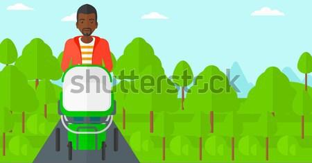 Man with plant and wheelbarrow. Stock photo © RAStudio