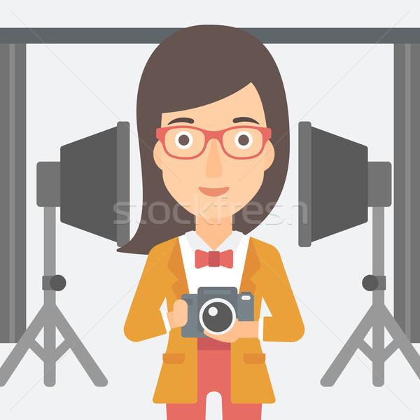 Sorridere fotografo fotocamera donna foto Foto d'archivio © RAStudio
