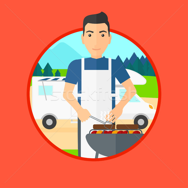 Man having barbecue in front of camper van. Stock photo © RAStudio