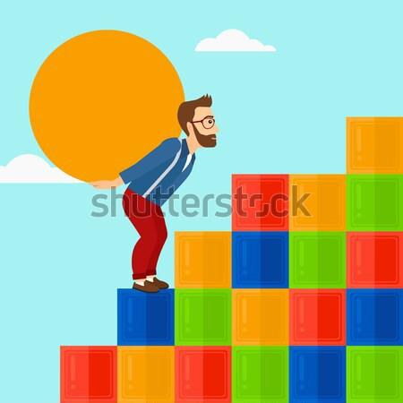 Man carrying concrete ball uphill. Stock photo © RAStudio