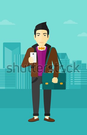 Homme séance valise gare asian jeune homme Photo stock © RAStudio